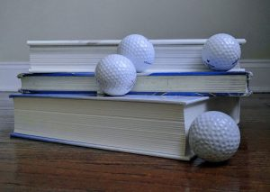 books and golf balls