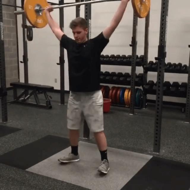 Teenage boy lifting weights
